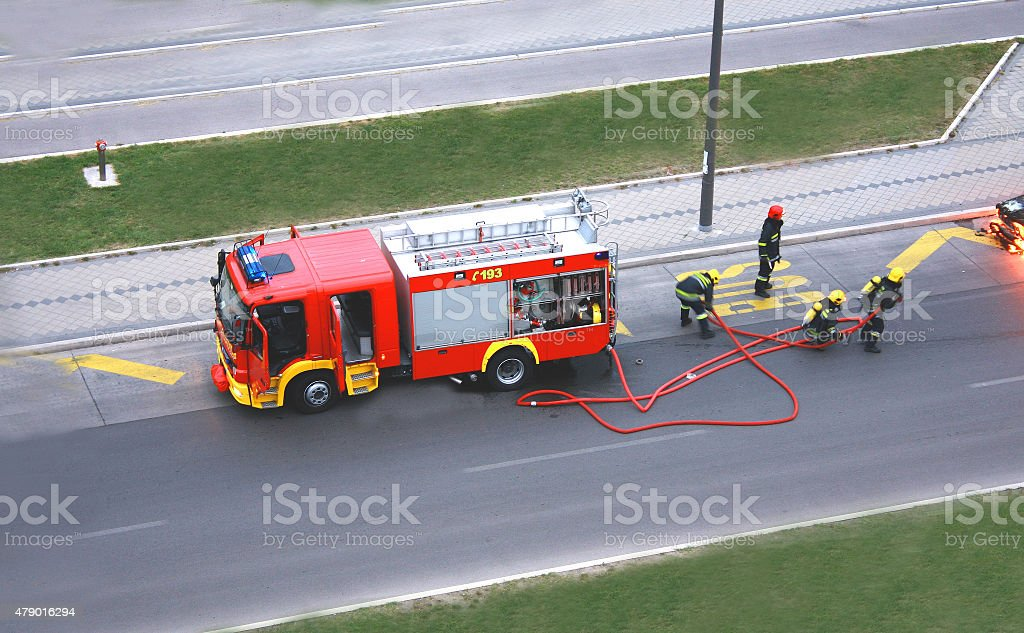 fire drill with four man who fight with the fire stock photo