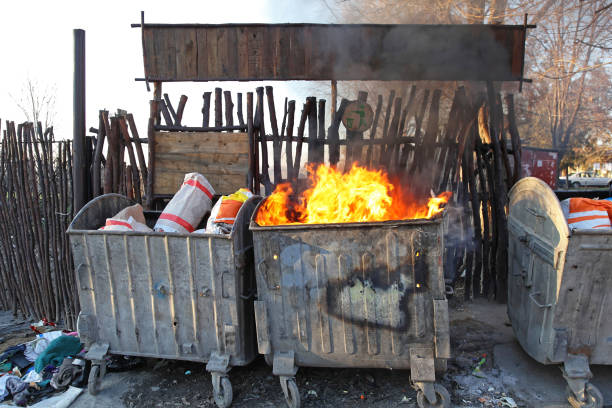 Fire Dumpster Burning Dumpster Fire Disaster Pollution Communal Problem dumpster fire stock pictures, royalty-free photos & images