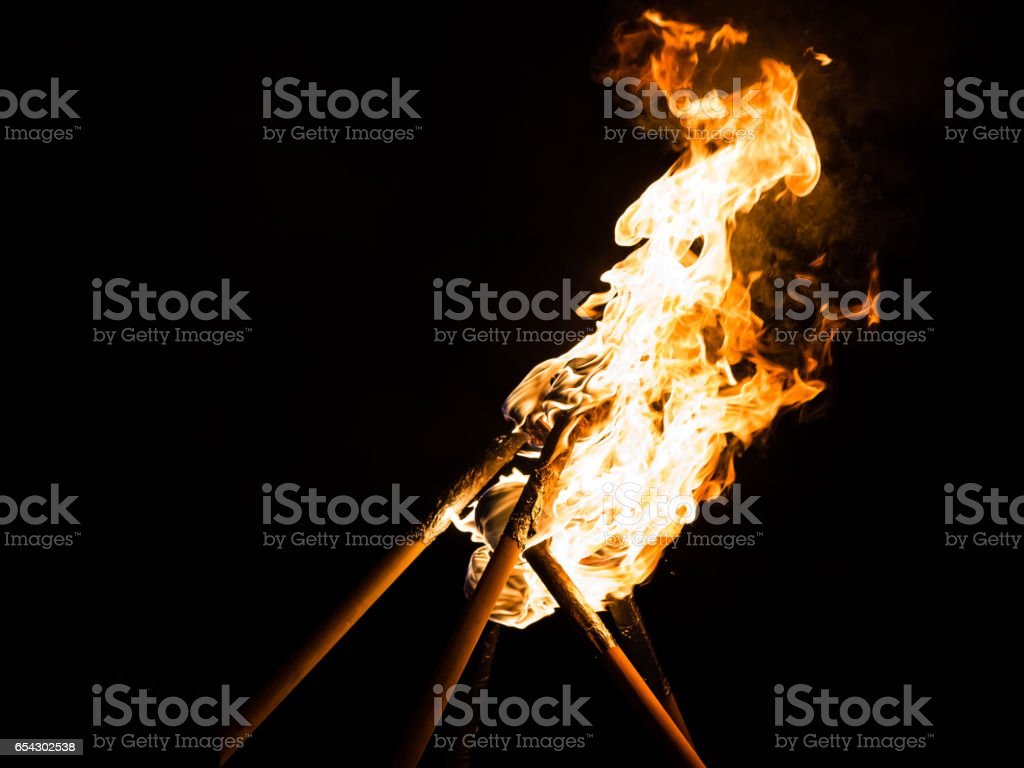 Fire eating torches with flame stock photo
