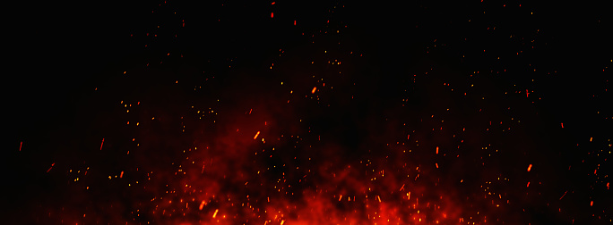 Fire sparks background. Abstract dark glitter fire particles lights. bonfire in motion blur.