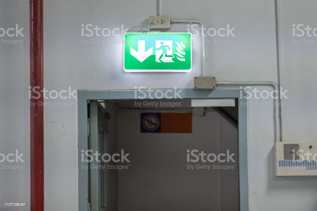 Fire Emergency Exit light box sign setup over exit door in the old...