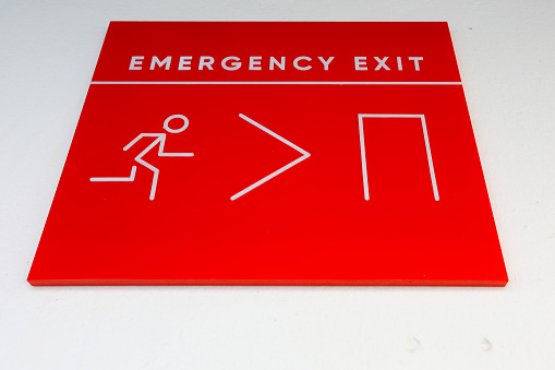 istock Fire emergency exit sign on a white wall. 1030747266