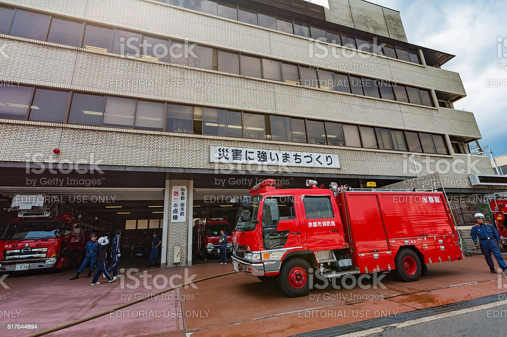 Fire engine and men outside the Kyoto Fire Station in Kyoto, Japan
