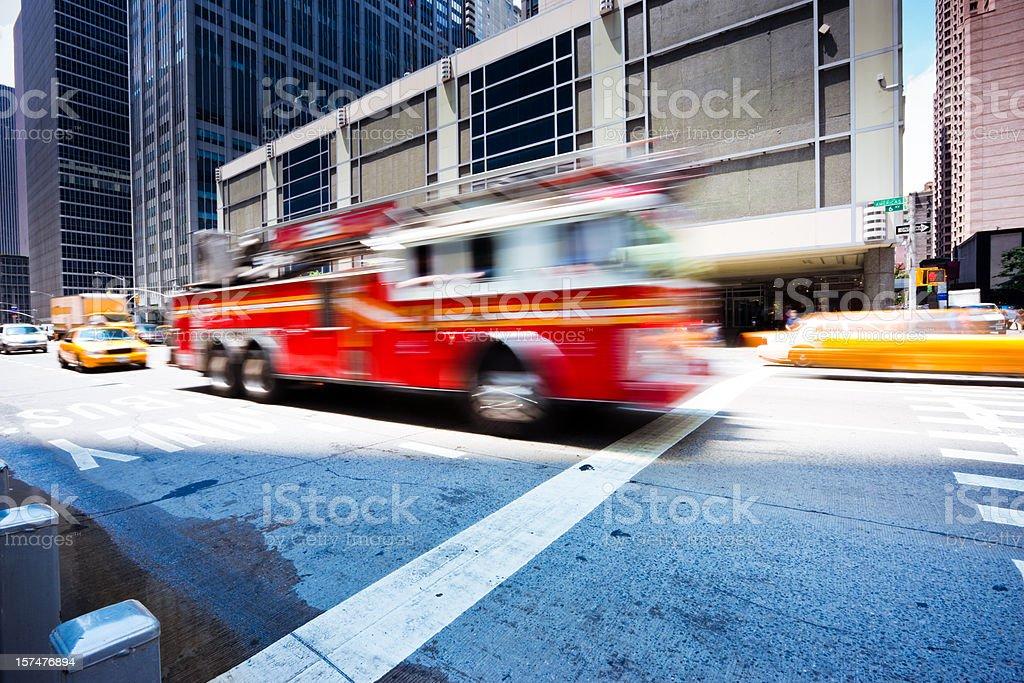Fire Engine rushing through sixth avenue New York City royalty-free stock photo