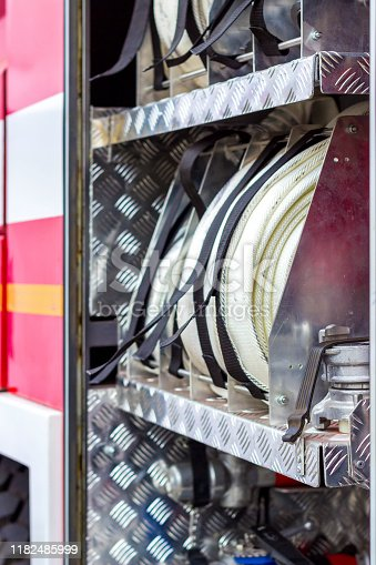 istock Fire engine, side view, neatly folded equipment inside the fire engine. 1182485999