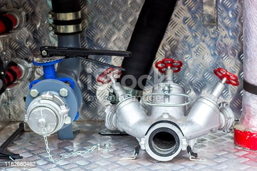 istock Fire engine, side view, neatly folded equipment inside the fire engine. 1182680462