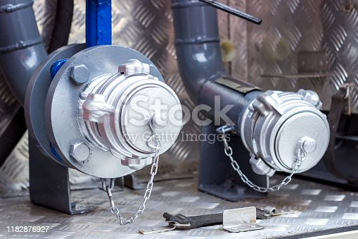 istock Fire engine, side view, neatly folded equipment inside the fire engine. 1182876927