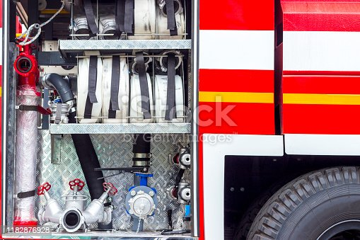 istock Fire engine, side view, neatly folded equipment inside the fire engine. 1182876928