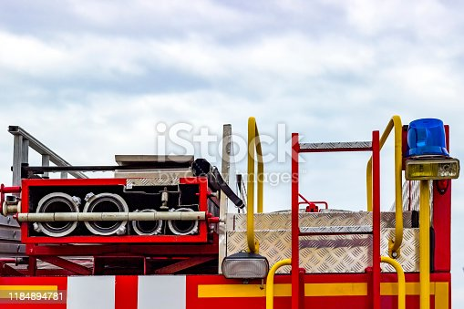 istock Fire engine, side view, neatly folded equipment inside the fire engine. 1184894781