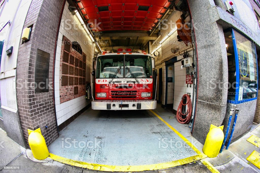 Fire engine vehicles parked at a fire station in New York stock photo
