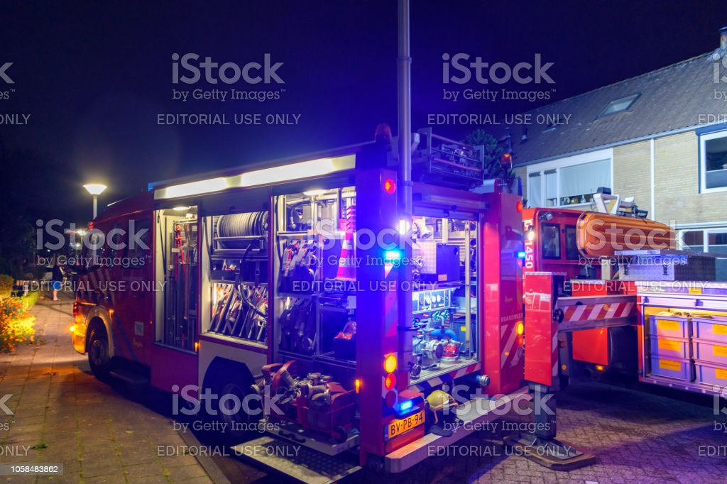 Fire engines of the Dutch fire department at a chimney fire in a...