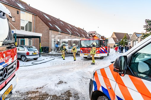 Fire engines of the Dutch Kampen fire department responding to a reported chimney fire that proofed to be a false alarm in a residential area in the city of Kampen in Overijssel, The Netherlands.