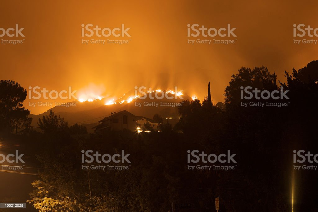 Fire Engulfing Neighborhood Hillside stock photo