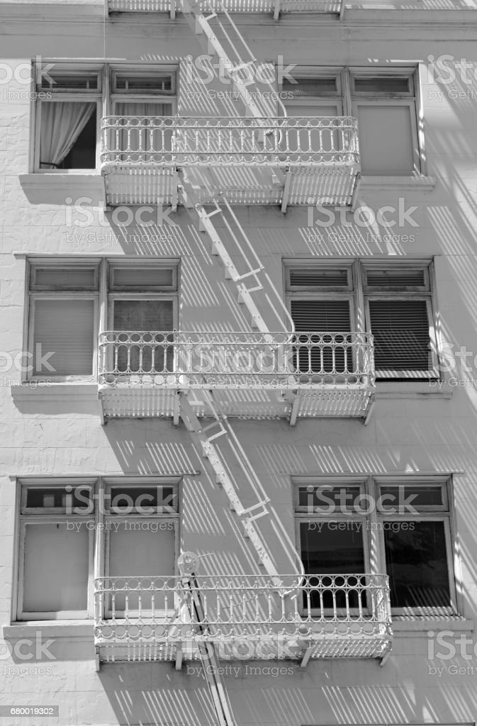 Fire Escape And Stairs On Exterior Of Walk Up Apartment Building  Royalty Free Stock Photo