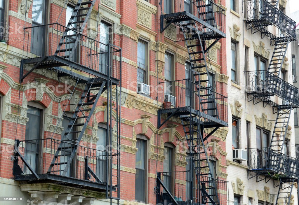 Fire escape and stairs on exterior of walk up apartment building royalty-free stock photo