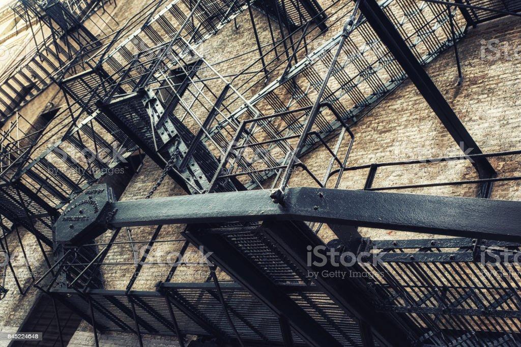 Fire Escape in Dark Alley stock photo