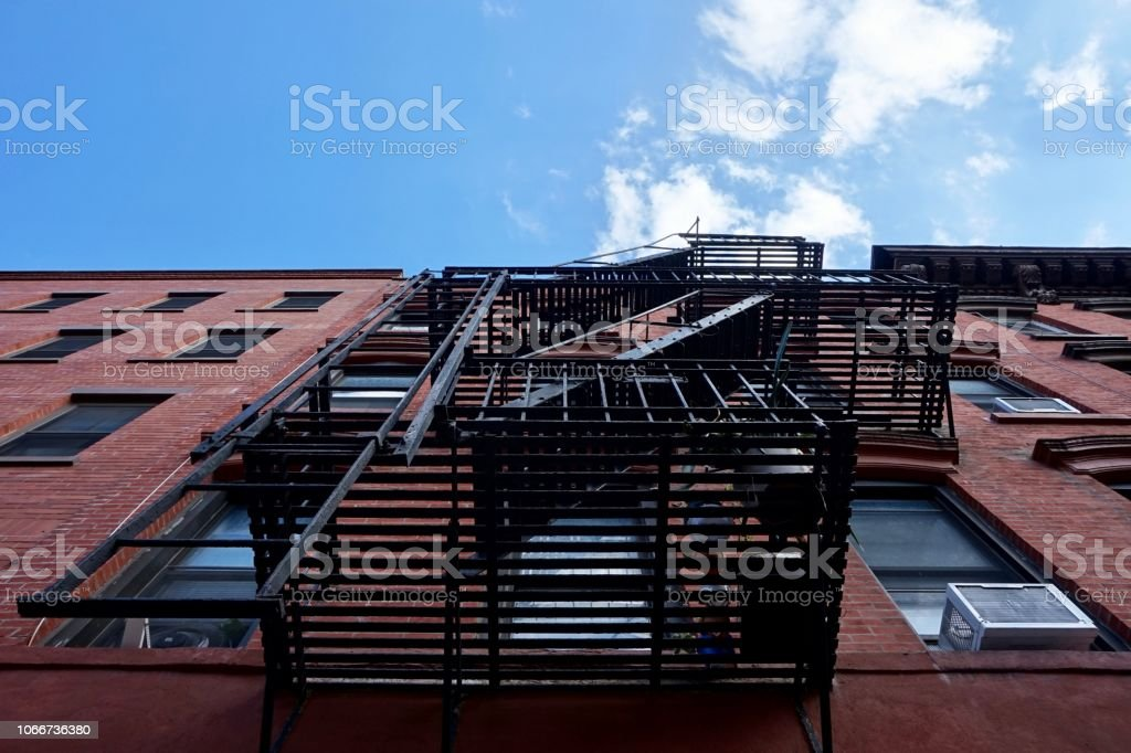 Greenpoint, Brooklyn, New York, NY. Metal fire exit stairs on the...