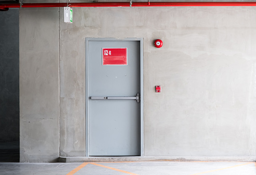istock Fire exit door for emergency case. 1203982701
