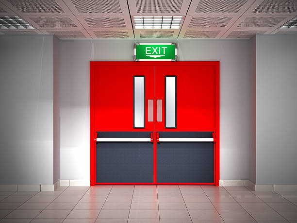 fire exit - exit sign stock photos and pictures
