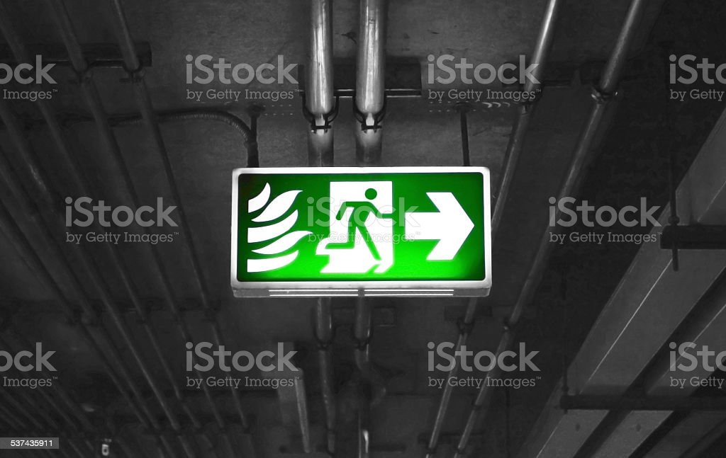 Fire exit sign in car park building stock photo