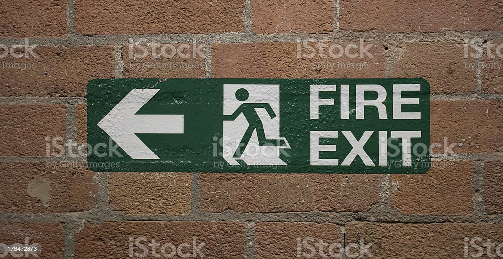 Fire Exit sign on bricks stock photo