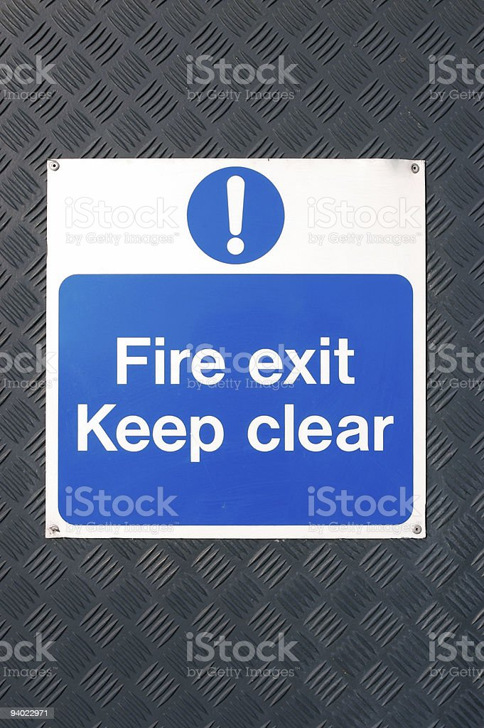 Fire Exit sign on metal door royalty-free stock photo