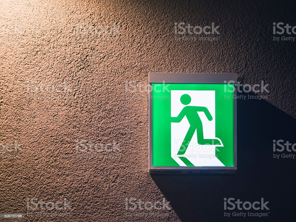 Fire Exit Sign on wall Building Safety Signage stock photo