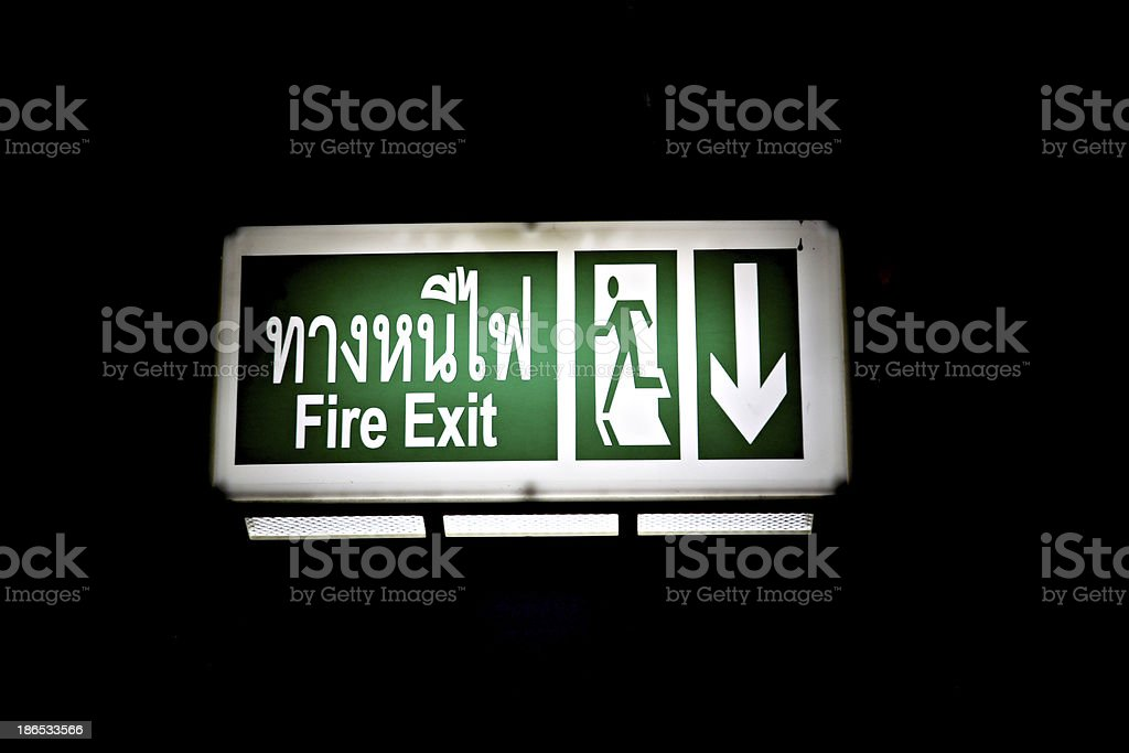 Fire exit signs on black background.