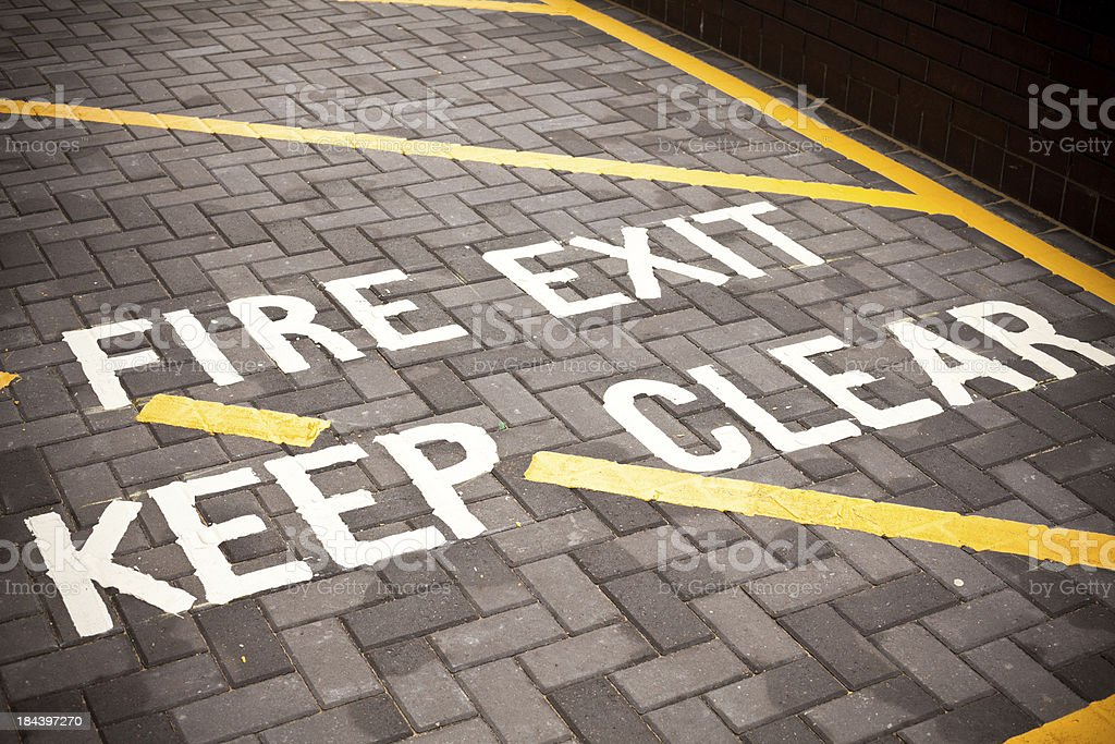 Fire Exit, Street Sign on asphalt royalty-free stock photo
