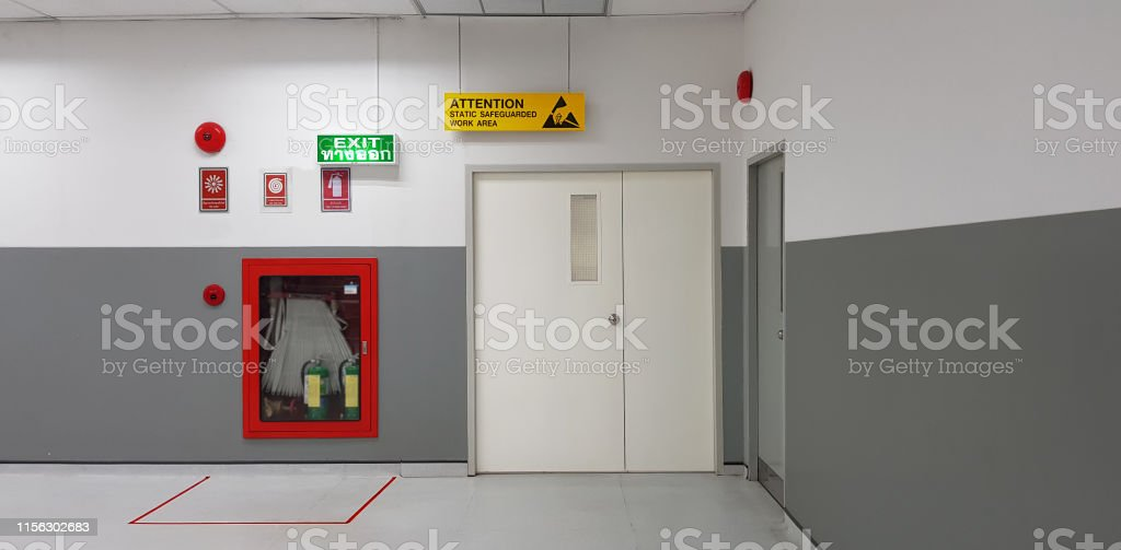 Fire exit way door and fire exit sign lightbox and fire hose in...