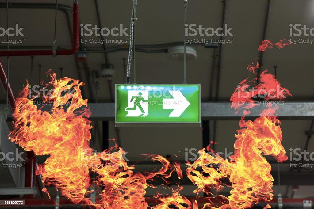 Fire exits in car park and frame of fire burn. stock photo