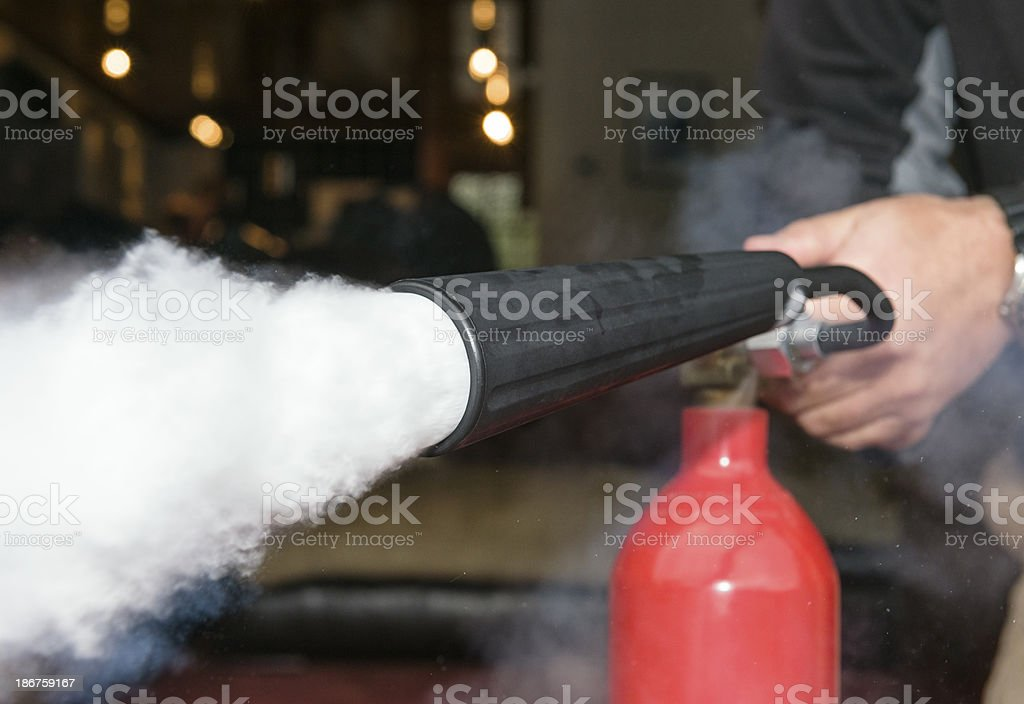 Fire Extinguisher Action in the Home stock photo
