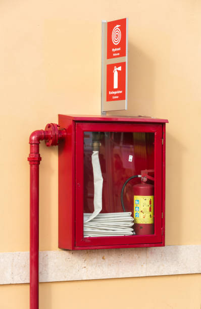 Fire extinguisher and hydrant stock photo