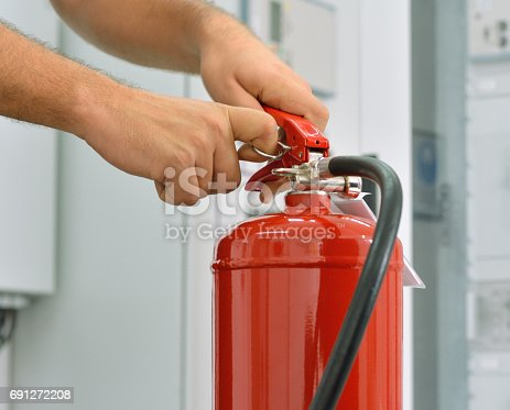 Firefighter showing how to use a fire extinguisher.