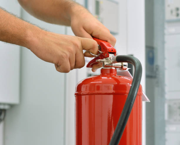 Fire extinguisher in action stock photo