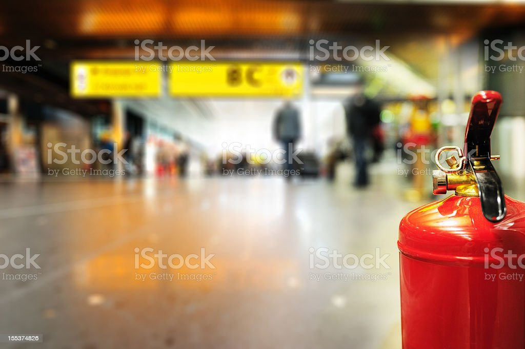 Fire extinguisher in airport terminal building royalty-free stock photo