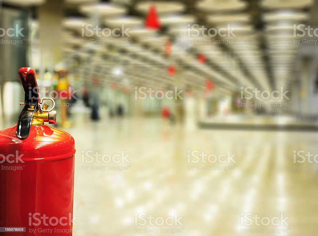 Fire extinguisher in airport terminal building stock photo