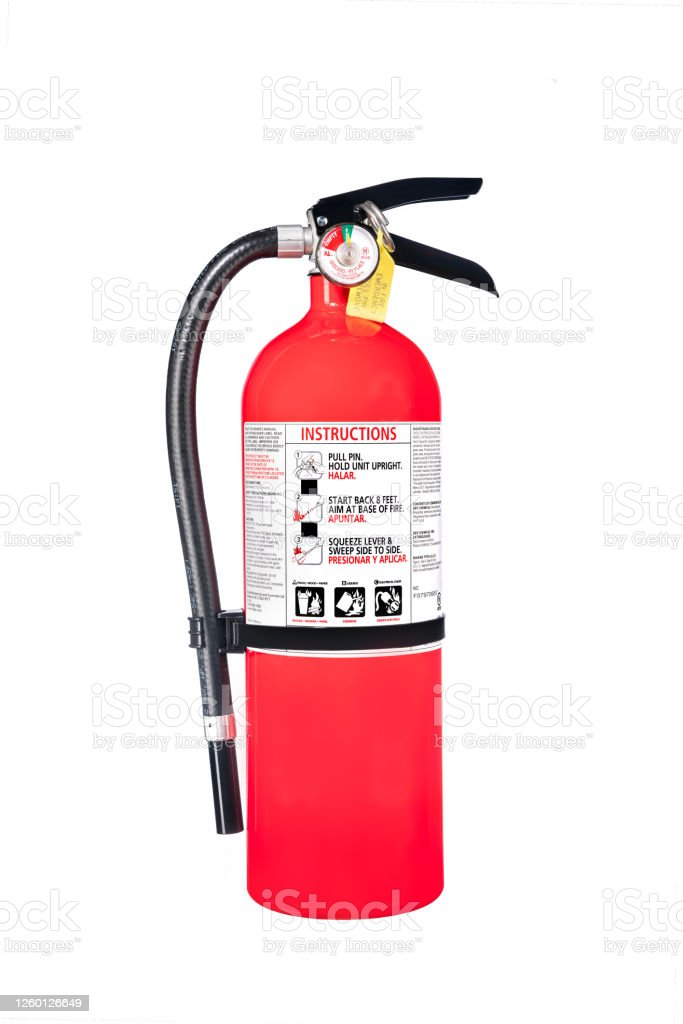 Fire extinguisher isolated on white A classic red fire extinguisher isolated on white for use as a design element or safety inference for home and business protection. Business Stock Photo