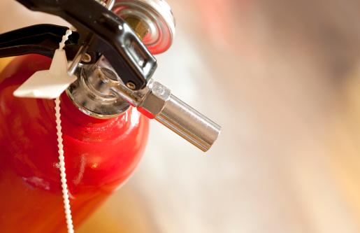 studio shot of fire extinguisher