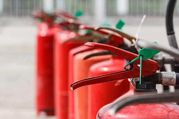 fire extinguisher red tank in outdoor - coffre fort équipement de sécurité photos et images de collection