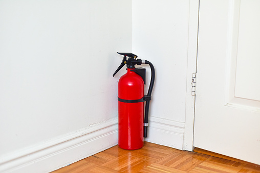 A fire extinguisher against a wall