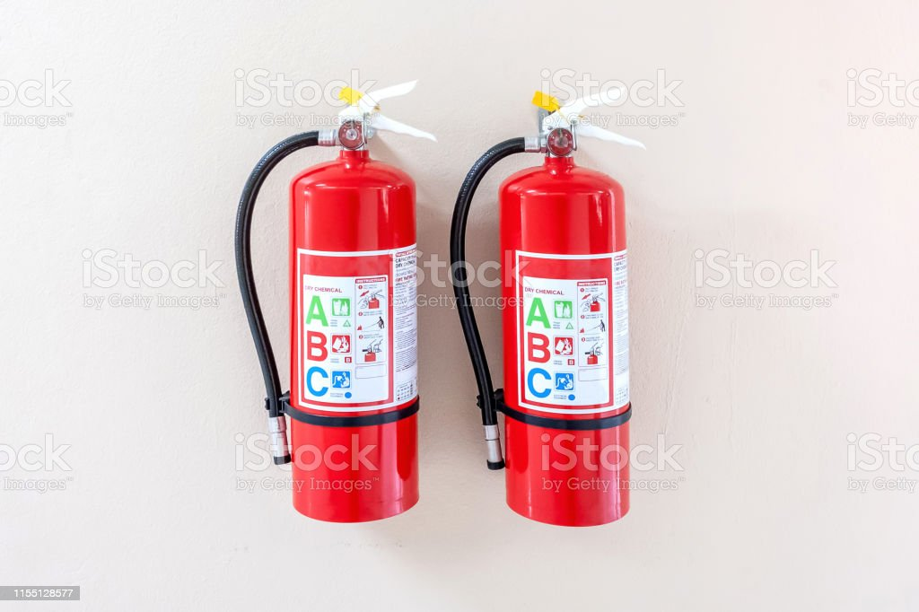 Fire extinguisher system on the wall background, powerful emergency...