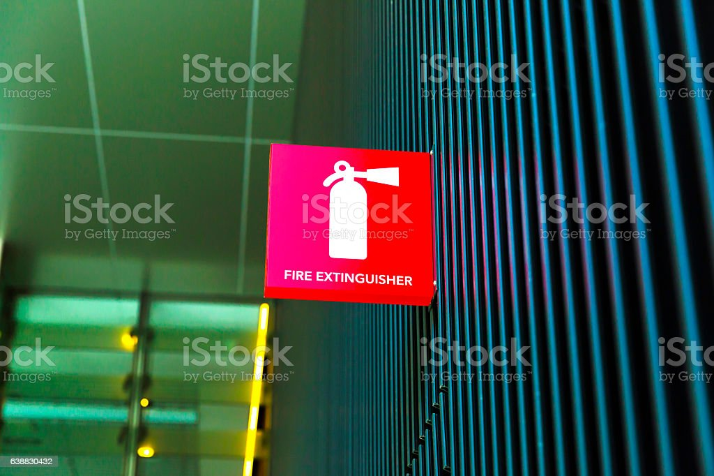 Fire extingusher sign on the wall of building, copy space stock photo