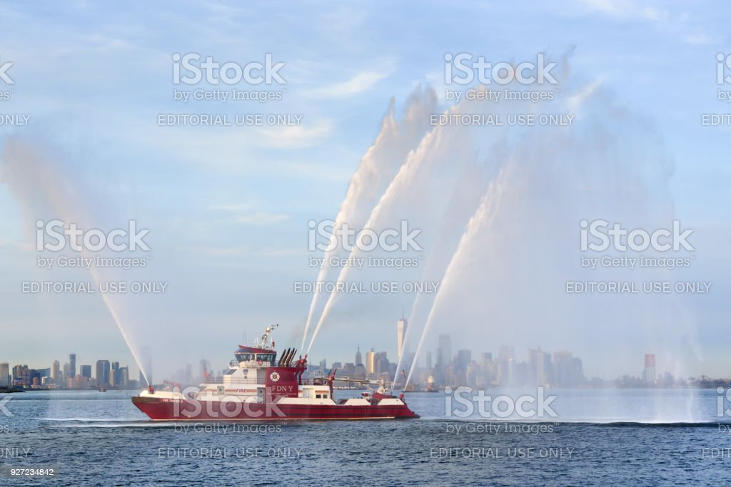 Fire Fighter Ii Fireboat With Waterjets At Full Power In Front Of