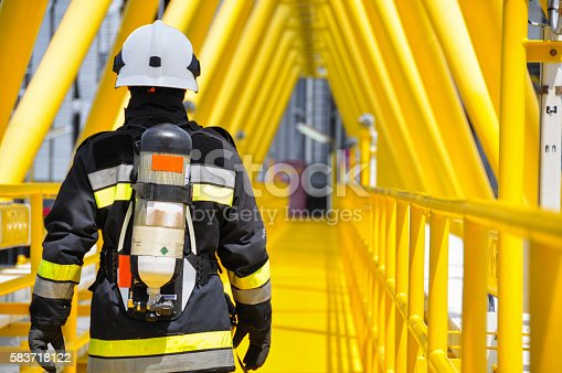 istock Fire fighter on oil and gas industry, successful firefighter 583718122