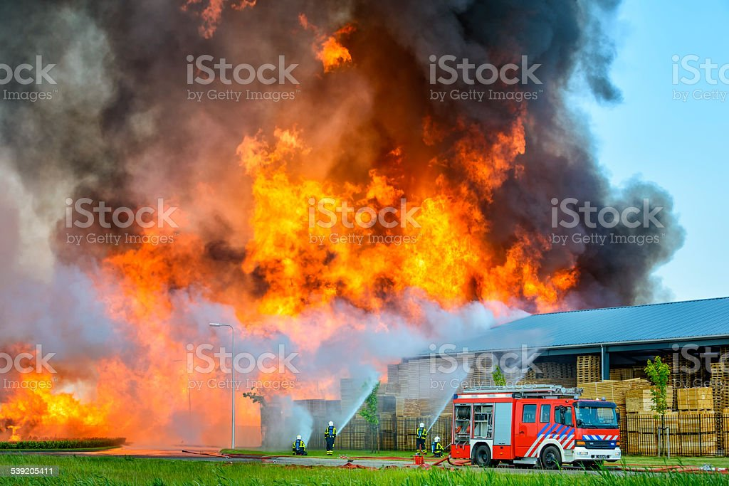 Fire fighters at an industrial inferno stock photo