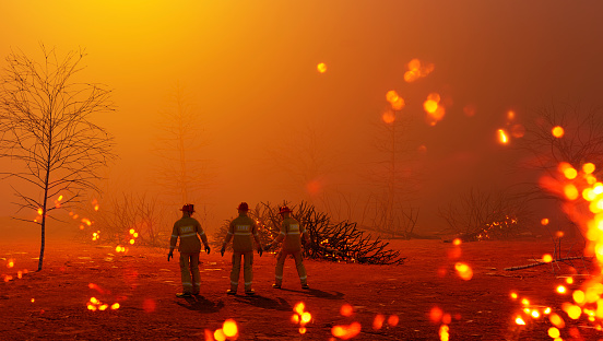 Three fire fighters stand close together in the middle of a burning forest. Concept of fighting forest fires which have startet due to natural disasters or arson. The image is a 3D render.