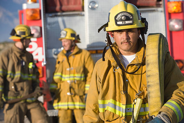 fire fighters - firefighter stock photos and pictures