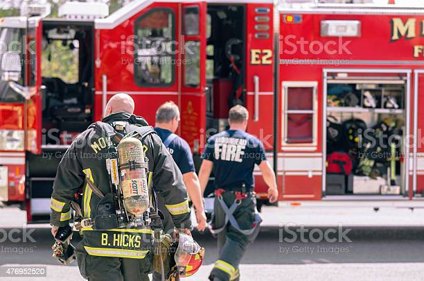 Fire Fighters Returning To Firetruck After Drill
