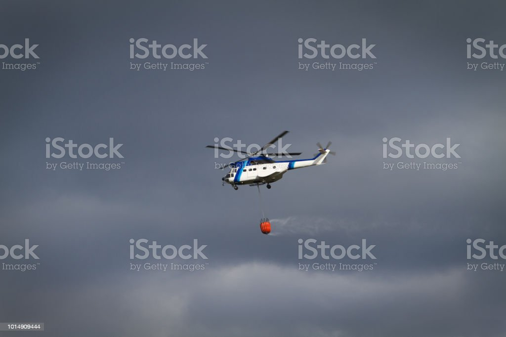 Fire fighting helicopter with basket. stock photo